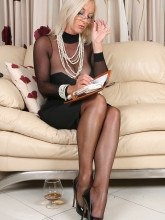 Amazing Astrid gallery: Blonde mature in tan nylons