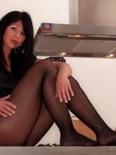 Desyra Noir in tan pantyhose and gold miniskirt