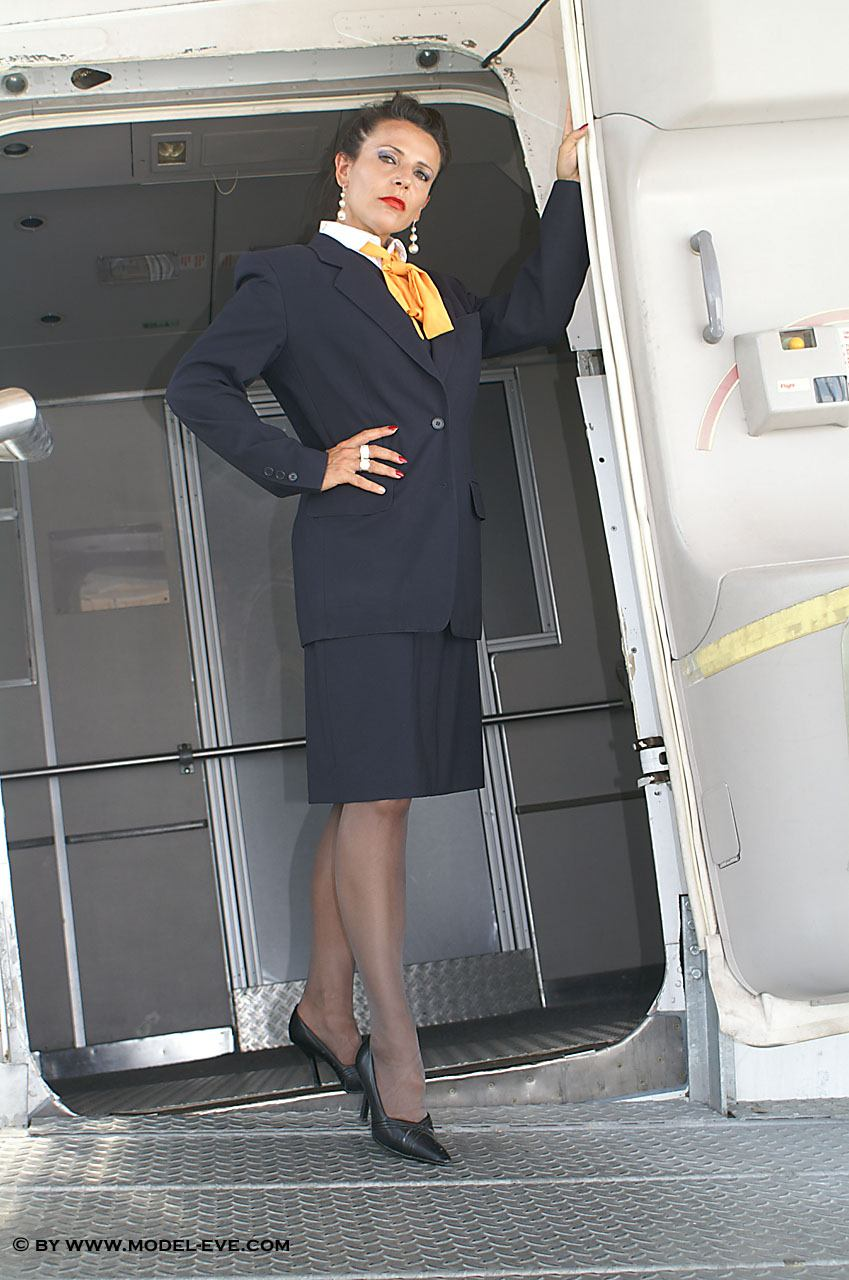 Model Eve photos: Eve as an Air hostess in shiny pantyhose