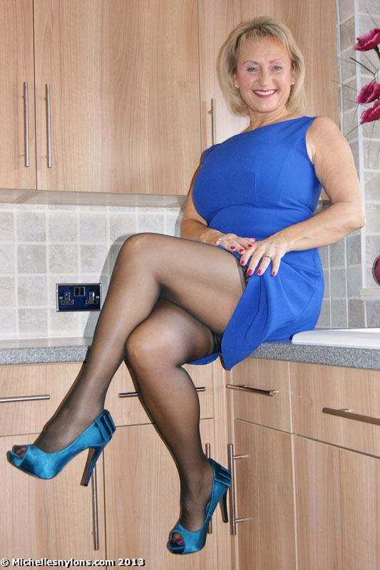 Busty mature in high heels and nylons