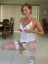 Desirae in pink corset and white stockings