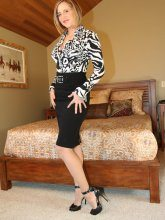 Desirae with glasses teasing in seamed nylon stockings