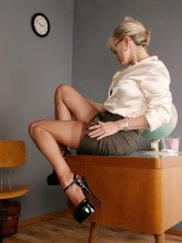 Leggy teacher in nylons and high heels