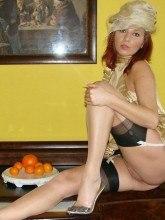 Sexy legs encased in glossy nylon - Vixen Nylons